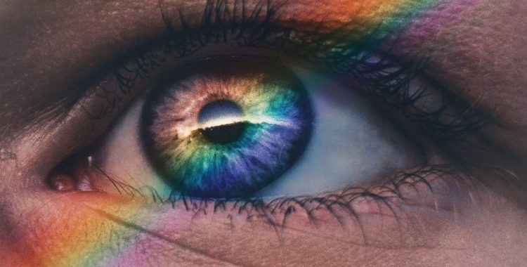 An open eye with a rainbow over it.