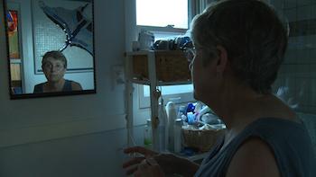 Still of Karen Marshall looking in the mirror.