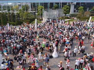 An outdoor crowd at a comic and fan convention.