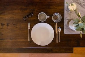 Carefully placed dining set on a wooden table.